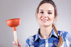 Handywoman with plunger Royalty Free Stock Photography