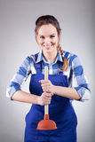 Handywoman with a plunger Stock Photo