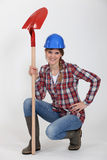 Handywoman with a shovel. Royalty Free Stock Photos
