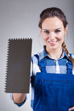 Handywoman with spatula. Vertical view of handywoman with a spatula Stock Photos
