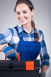 Handywoman with a toolbox Stock Images