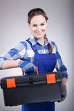 Handywoman with a toolbox Stock Photography