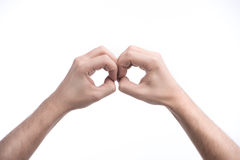 Handzeichen. Nahaufnahme des Menschen ein Zeichen machend, während Sie auf whi lokalisiert werden Lizenzfreie Stockfotos