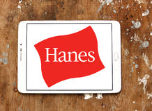 Hanes logo. Logo of fashion company Hanes on samsung tablet on wooden background royalty free stock image