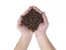 Hanful van koffiezaden Royalty-vrije Stock Afbeeldingen