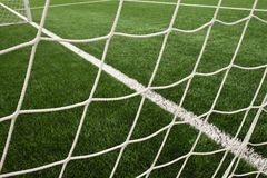 Hang bended soccer nets, soccer football net. Grass on football playground Stock Photos