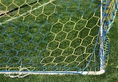 Hang bended soccer nets, soccer football net. Grass on football playground in the background Stock Images