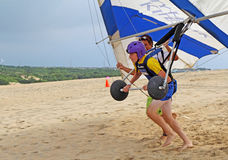 Hang glide student prepares for takeoff on sand dunes in North C Stock Photos
