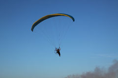 Hang-glider. Hang glider in the flies towards smoking factory Royalty Free Stock Photos