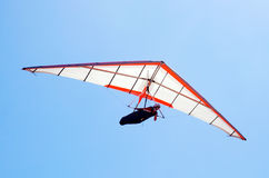 Hang glider. Young woman with red white wing over sand dune on famous australian city beach Cronulla. Sydney, NSW, Australia Stock Images