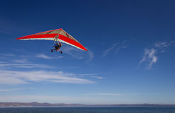 Hang glider. An hang glider flying over Bracciano lak,e, near Rome, italy in a very clear, sunny day Royalty Free Stock Photography