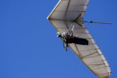 Hang glider. Against blue ski royalty free stock images