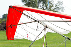 Hang Glider Closeup. Hang glider wing or sail airframe or triangle control frame and harness stationary on ground Royalty Free Stock Image