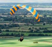 Hang Glider, Coaley-Spitze, Gloucestershire, Vereinigtes Königreich lizenzfreies stockfoto