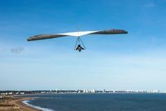Hang-glider flies over the Punta Ballena cape, Uruguay Royalty Free Stock Image