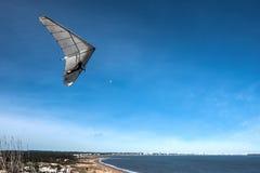 Hang-glider flies over the Punta Ballena cape, Uruguay Stock Image