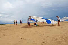 Hang glider flight check on sand dunes in North Carolina Royalty Free Stock Photo