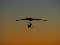 Hang glider flight. On sunset background Stock Images