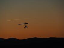 Hang glider flight. On sunset background Royalty Free Stock Photo