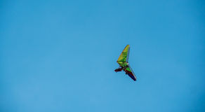 Hang-glider flying along blue sky Royalty Free Stock Photo