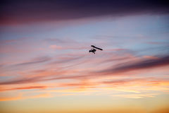 Hang glider flying in clouds Royalty Free Stock Photography