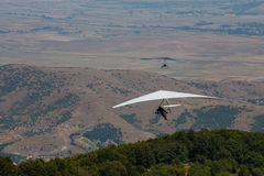 Hang glider flying in the mountains in Makedonia Royalty Free Stock Image