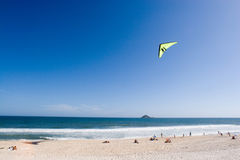 Hang glider flying over beach Royalty Free Stock Images