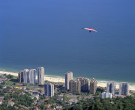 Hang glider. Flying over the Sao Conrado neighborhood after jumping the ramp located in Pedra Bonita Stock Images