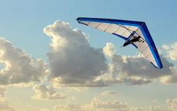 Hang Glider. Flying in the sky on blue day Royalty Free Stock Photography