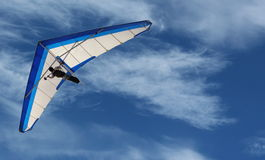 Hang Glider. Flying in the sky on a bright blue day Royalty Free Stock Photo