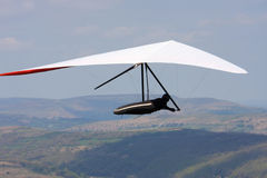 Hang glider flying Stock Images