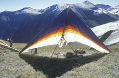 Hang glider on ground with mountains in background, Hang Gliding Festival, Telluride, Colorado Stock Image