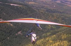 Hang glider on ground with mountains in background, Hang Gliding Festival, Telluride, Colorado Royalty Free Stock Photography