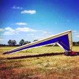 Hang glider. On the ground with summer sky Royalty Free Stock Photos