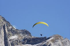 Hang Glider jumping from swiss mountain. Royalty Free Stock Image