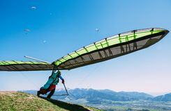Free Hang Glider Launch From Top Of Hill Stock Photography - 113911672