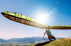 Hang glider launch from top of hill Royalty Free Stock Photo