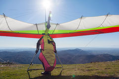 Hang glider. Launching off a mountain in Greece royalty free stock images