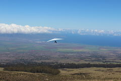 Hang Glider at Maui Hawaii. A hang glider running to jump off the side of Haleakala volcano on the tropical island of Maui, Hawaii royalty free stock photo