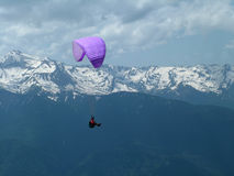 Hang-glider and mountains, a k Stock Images
