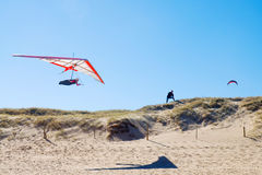 Hang glider over beach Royalty Free Stock Image