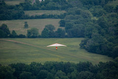 Hang Glider over Field Stock Photography