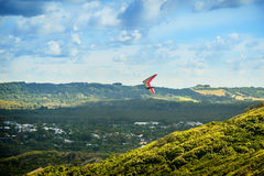 Hang Glider over the Valley Stock Photo
