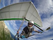 Hang glider pilot chot with action camera. Brave hangglider pilot selfie shot taken with wide angle action camera Royalty Free Stock Photo