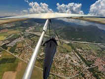 Hang glider pilot flies high over alpine terrain in Provance, Fr stock images
