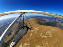 Hang glider pilot flies over mountain highlands in Slovakia Royalty Free Stock Image