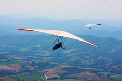 Hang glider pilot in Italian mountains Stock Photos