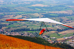 Hang glider pilot in Italian mountains Royalty Free Stock Images
