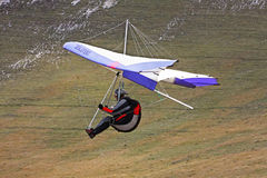 Hang glider pilot in Italian mountains Royalty Free Stock Photo