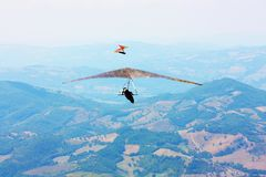 Hang glider pilot in Italian mountains Royalty Free Stock Photos